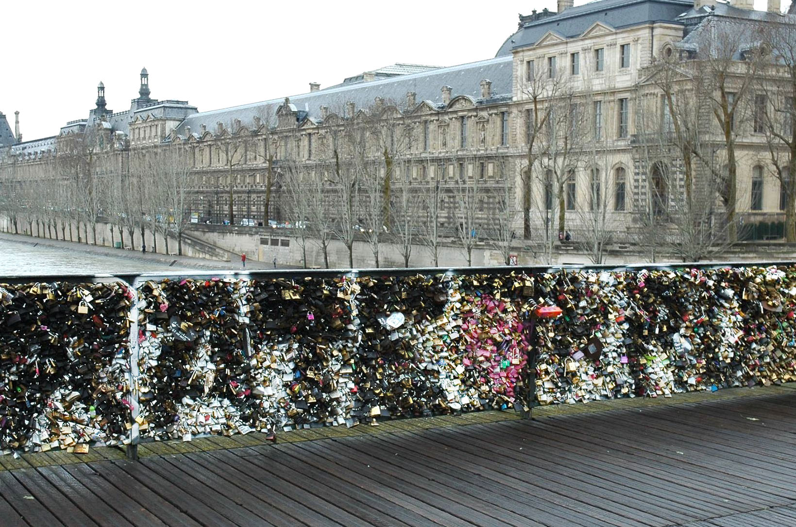 Paris no love locks the wall of locks create the perfect solid surface for graffiti you can make out biocorpaavc