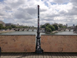 What's left of the Pont des Arts. A lamp missing, brought down by the weight of locks.