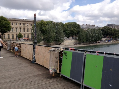 The Pont des Arts after 3 months of heavy tourist traffic.